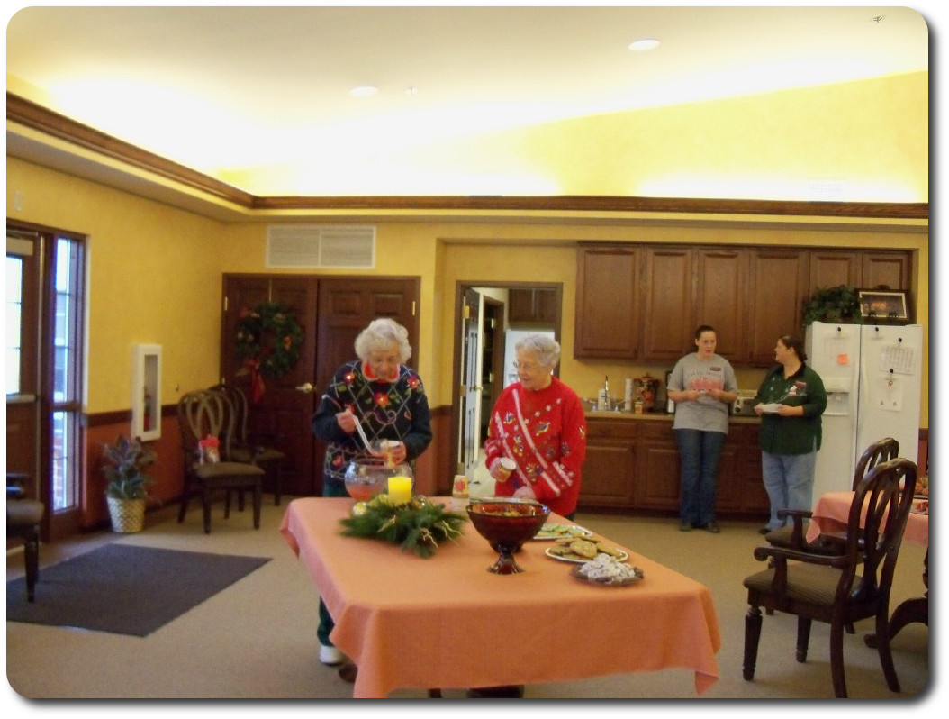 Residents enjoying punch at our Christmas Party