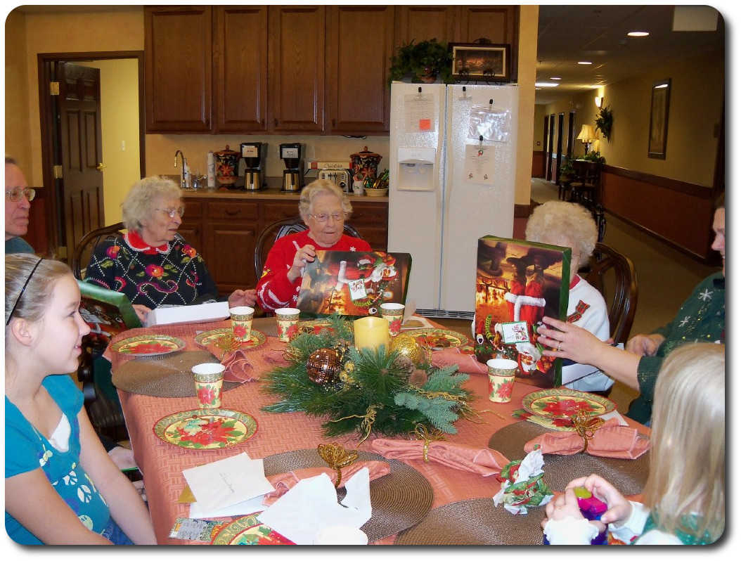 Residents enjoying Christmas Gifts from Santa