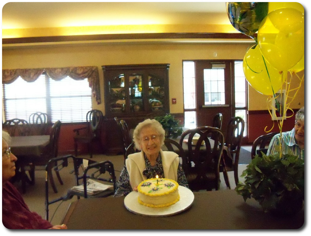 Resident enjoying birthday cake at our monthly birthday party.