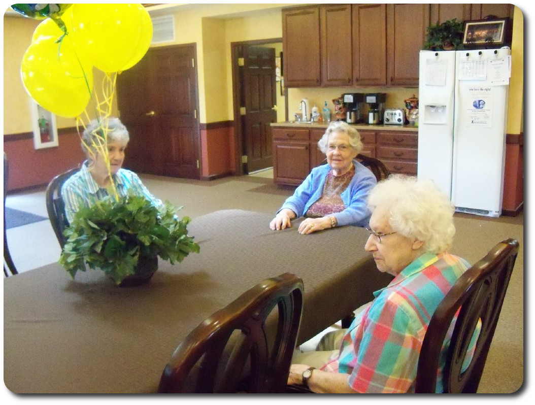 Residents enjoying friendly conversation.