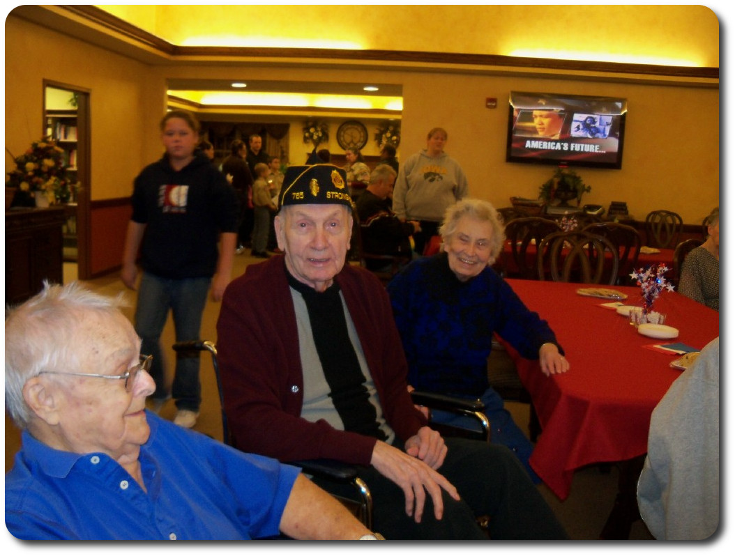 Residents and family enjoying Veteran's day party, honoring our Veterans.