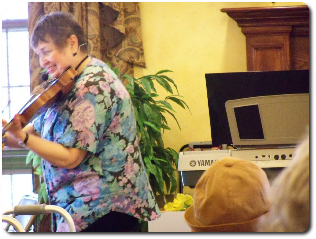 Residents enjoying music.