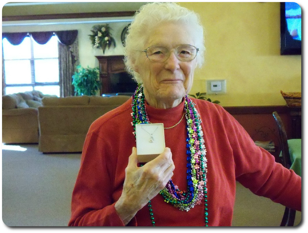 Resident showing her gift she won at Bingo.