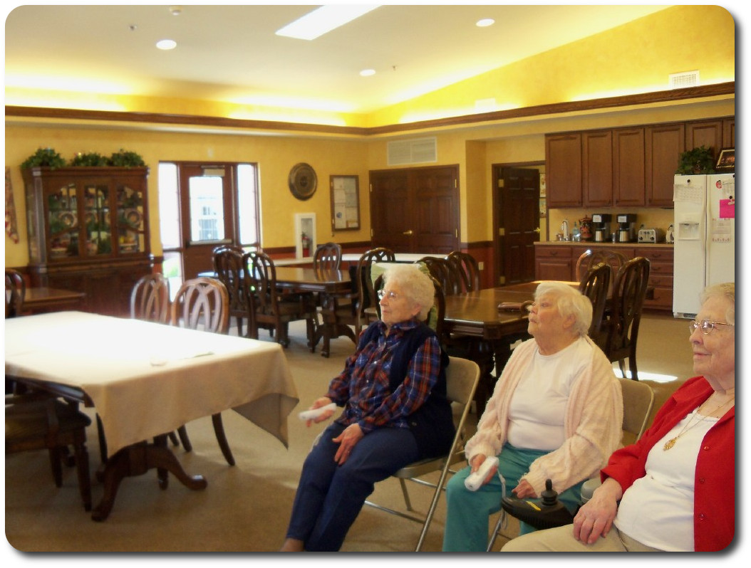 Residents playing WII bowling.