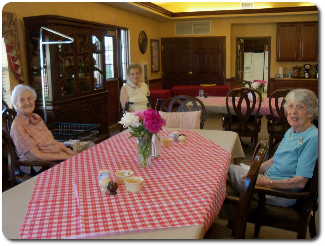 Residents enjoying monthly resident meal of choice, this paticular one was a picnic theme.